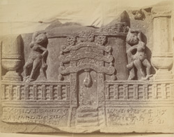 Sculpture panel showing a Jain stupa and torana, two dancing girls, with inscription beneath, from Mathura